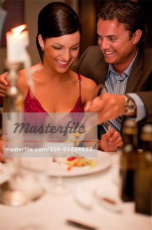 Couple having dinner in restaurant Stock Photo - Premium Royalty-Free, Image code: 614-06624023
