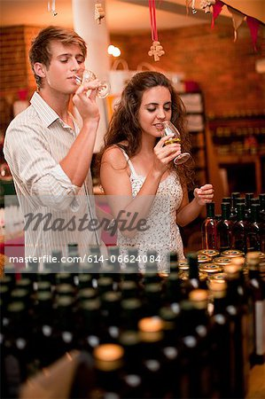 Couple tasting wine in grocery Stock Photo - Premium Royalty-Free, Image code: 614-06624084