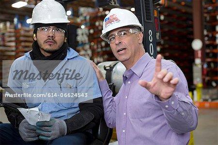 Worker and businessman in metal plant Stock Photo - Premium Royalty-Free, Image code: 614-06624543