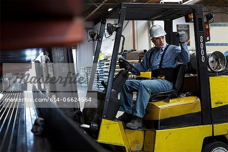 Worker using forklift in metal plant Stock Photo - Premium Royalty-Free, Image code: 614-06624564