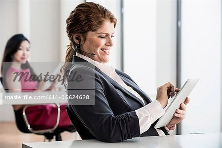 Businesswoman using tablet computer Stock Photo - Premium Royalty-Free, Image code: 614-06624628