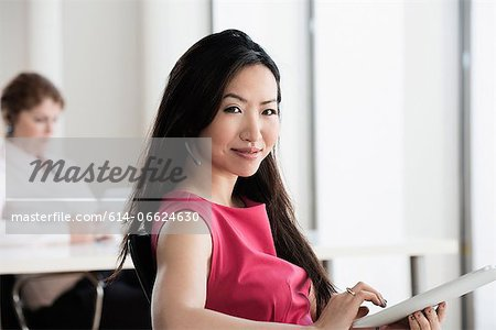Businesswoman using tablet computer Stock Photo - Premium Royalty-Free, Image code: 614-06624630