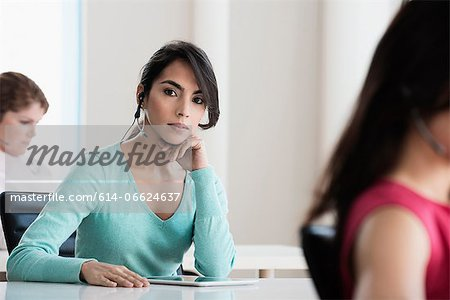 Businesswoman using tablet computer Stock Photo - Premium Royalty-Free, Image code: 614-06624637
