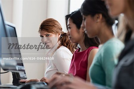 Businesswomen working at computers Stock Photo - Premium Royalty-Free, Image code: 614-06624658