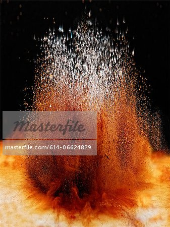 Dirt exploding on ground Stock Photo - Premium Royalty-Free, Image code: 614-06624829