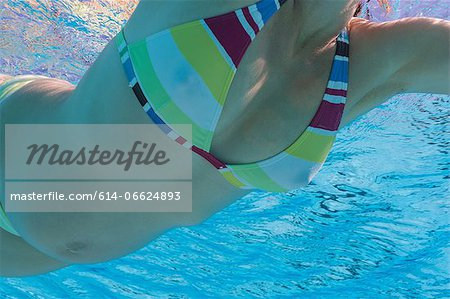 Pregnant woman swimming in pool Stock Photo - Premium Royalty-Free, Image code: 614-06624893