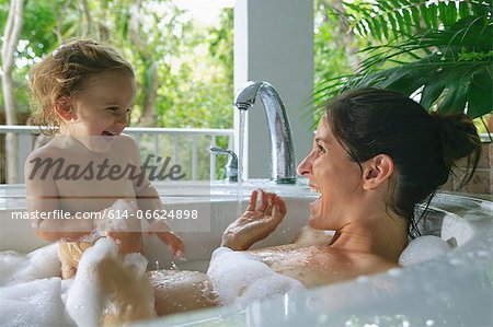 Pregnant mother and toddler in bath Stock Photo - Premium Royalty-Free, Image code: 614-06624898