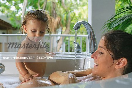 Pregnant mother and toddler in bath Stock Photo - Premium Royalty-Free, Image code: 614-06624899