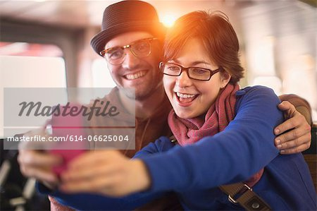 Couple taking picture with cell phone Stock Photo - Premium Royalty-Free, Image code: 614-06625004