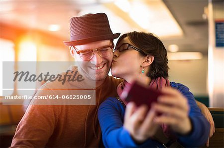 Couple taking picture with cell phone Stock Photo - Premium Royalty-Free, Image code: 614-06625005