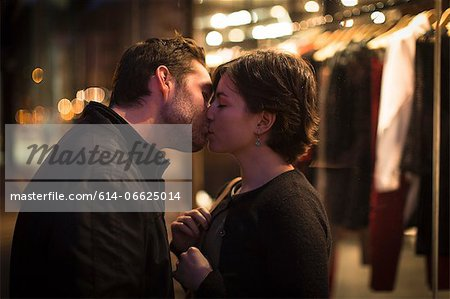 Couple kissing on city street at night Stock Photo - Premium Royalty-Free, Image code: 614-06625014