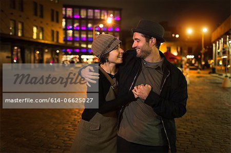 Couple hugging on city street Stock Photo - Premium Royalty-Free, Image code: 614-06625027
