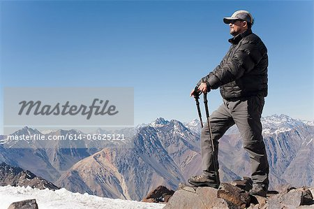 Hiker overlooking snowy mountains Stock Photo - Premium Royalty-Free, Image code: 614-06625121