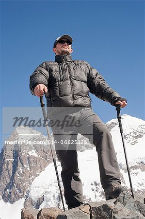 Hiker overlooking snowy mountains Stock Photo - Premium Royalty-Free, Image code: 614-06625125