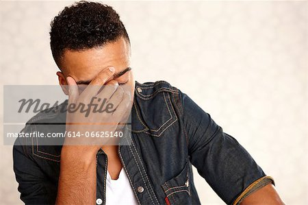 Close up of man's frustrated face Stock Photo - Premium Royalty-Free, Image code: 614-06625140