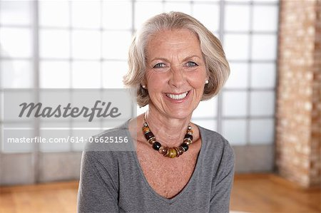 Older woman smiling indoors Stock Photo - Premium Royalty-Free, Image code: 614-06625156