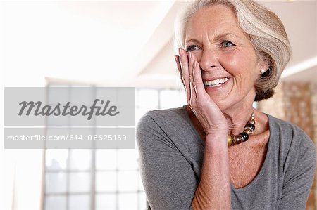 Smiling older woman gasping Stock Photo - Premium Royalty-Free, Image code: 614-06625159