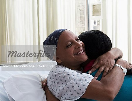 Daughter hugging mother at hospital Stock Photo - Premium Royalty-Free, Image code: 614-06718039