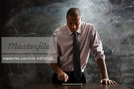 Man using digital tablet Stock Photo - Premium Royalty-Free, Image code: 614-06718125