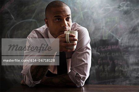 Man drinking cup of coffee Stock Photo - Premium Royalty-Free, Image code: 614-06718128