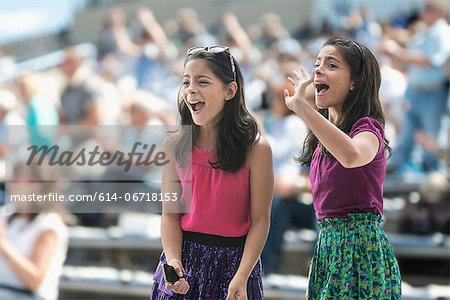 Two excited girls at a pop concert Stock Photo - Premium Royalty-Free, Image code: 614-06718153
