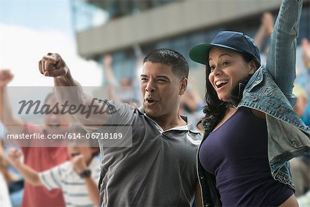 Couple cheering at sports game Stock Photo - Premium Royalty-Free, Image code: 614-06718189
