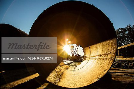 Sunrise viewed through concrete pipe Stock Photo - Premium Royalty-Free, Image code: 614-06718274