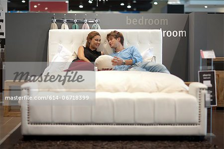 Couple shopping for mattress in store Stock Photo - Premium Royalty-Free, Image code: 614-06718399