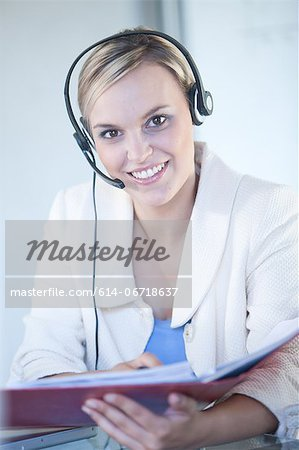 Businesswomen wearing headset at desk Stock Photo - Premium Royalty-Free, Image code: 614-06718637