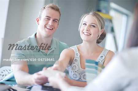 Couple looking at paint swatches Stock Photo - Premium Royalty-Free, Image code: 614-06718641