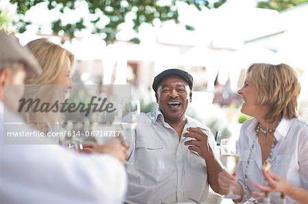 Older friends having wine together Stock Photo - Premium Royalty-Free, Image code: 614-06718717