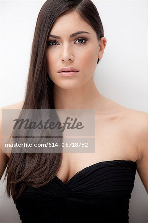 Woman wearing evening gown Stock Photo - Premium Royalty-Free, Image code: 614-06718752