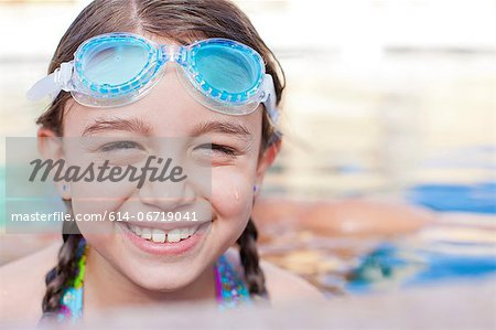 Close up of girl wearing goggles in pool Stock Photo - Premium Royalty-Free, Image code: 614-06719041
