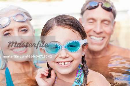 Girl and grandparents swimming in pool Stock Photo - Premium Royalty-Free, Image code: 614-06719042