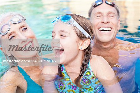 Girl and grandparents swimming in pool Stock Photo - Premium Royalty-Free, Image code: 614-06719043