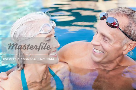 Older couple swimming in pool Stock Photo - Premium Royalty-Free, Image code: 614-06719044