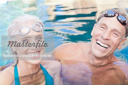 Older couple swimming in pool Stock Photo - Premium Royalty-Free, Image code: 614-06719048