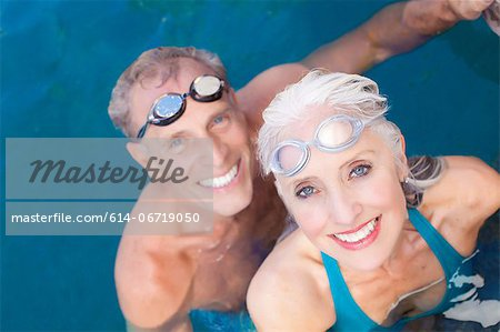 Older couple swimming in pool Stock Photo - Premium Royalty-Free, Image code: 614-06719050