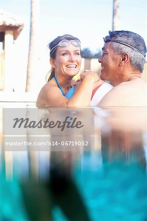 Couple swimming together in pool Stock Photo - Premium Royalty-Free, Image code: 614-06719052