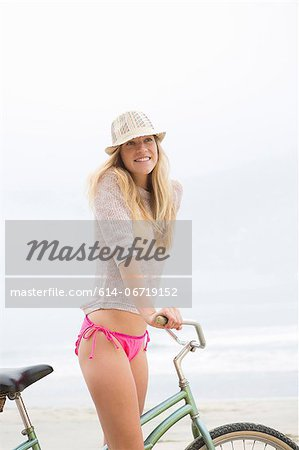 Woman on bicycle on beach Stock Photo - Premium Royalty-Free, Image code: 614-06719152