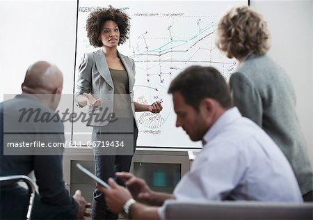 Businesswoman talking in meeting Stock Photo - Premium Royalty-Free, Image code: 614-06719434
