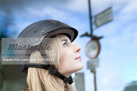 Woman wearing bicycle helmet outdoors Stock Photo - Premium Royalty-Free, Image code: 614-06719632