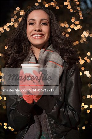 Woman having coffee on city street Stock Photo - Premium Royalty-Free, Image code: 614-06719717