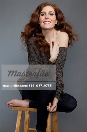 Woman sitting on stool Stock Photo - Premium Royalty-Free, Image code: 614-06719735