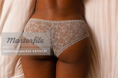 Close up of woman wearing panties Stock Photo - Premium Royalty-Free, Image code: 614-06720117