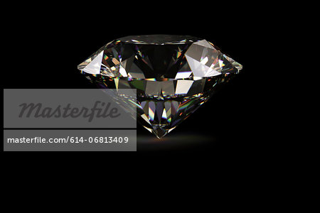 Diamond against black background Stock Photo - Premium Royalty-Free, Image code: 614-06813409