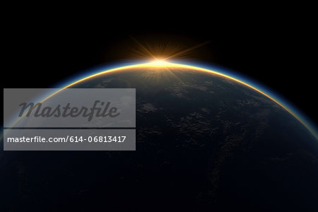 Sunlight eclipsing planet earth Stock Photo - Premium Royalty-Free, Image code: 614-06813417