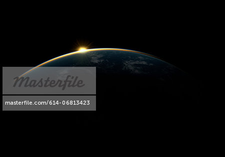 Sunlight eclipsing planet earth Stock Photo - Premium Royalty-Free, Image code: 614-06813423