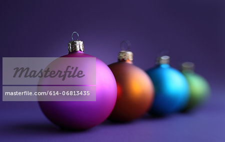 Colorful row of christmas baubles Stock Photo - Premium Royalty-Free, Image code: 614-06813435