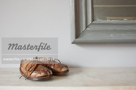 Brown leather shoes on mantelpiece Stock Photo - Premium Royalty-Free, Image code: 614-06813499